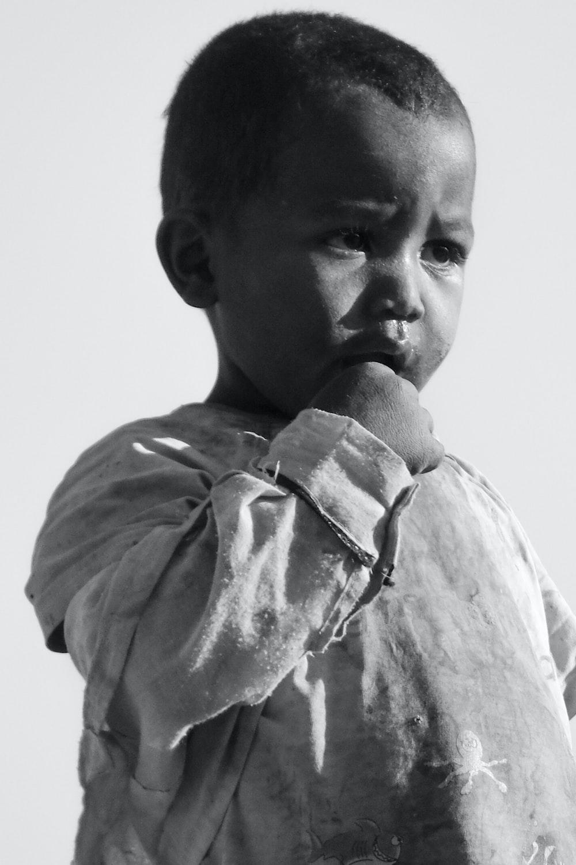 boy sucking his finger