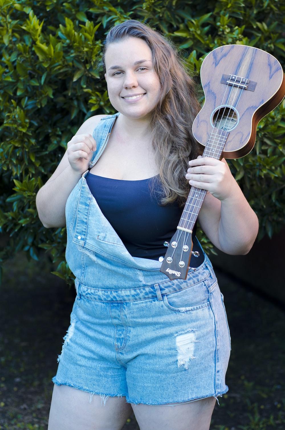 woman carrying ukulele