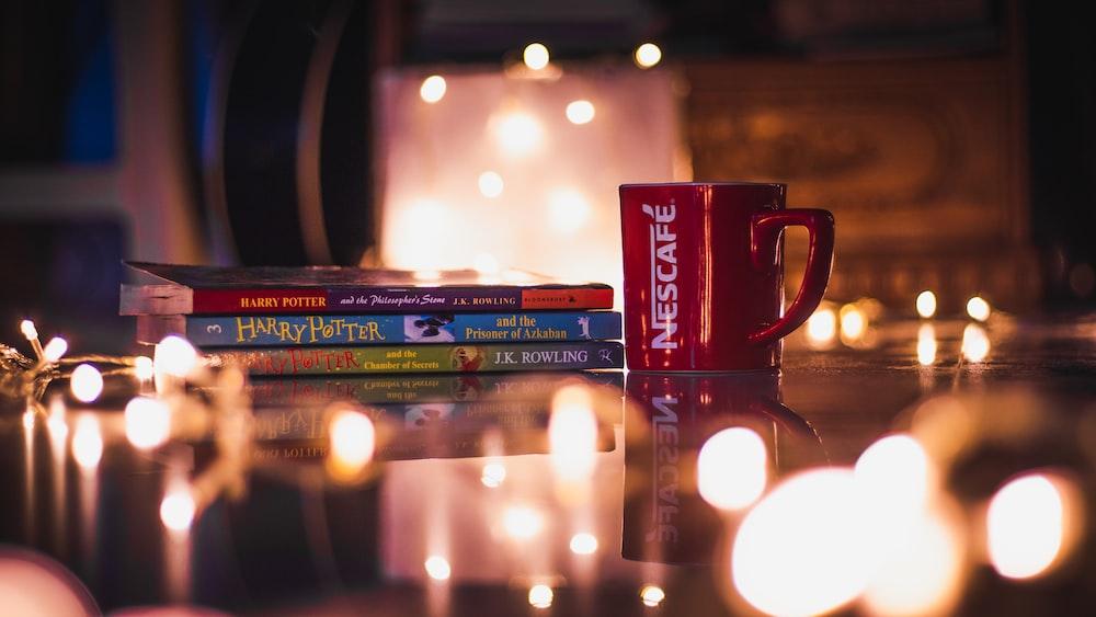 Nescafe mug beside story books
