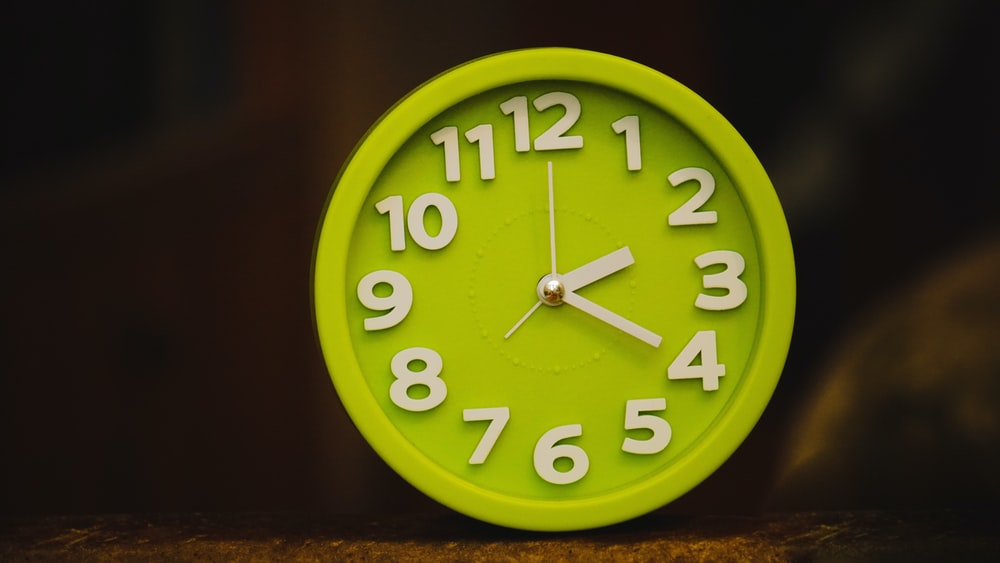 round green clock at 2:20