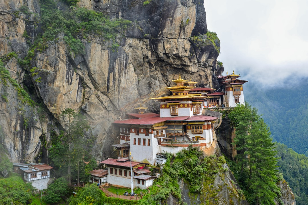 Another shot of the breathtaking scenery of Taktsang Monastery (1692) and Bhutan mountainous landscape. It was still early morning when a few friends and I got there. The clouds/mist are still low and sometimes block the view of the temple.   Read more about it here: https://en.wikipedia.org/wiki/Paro_Taktsang
