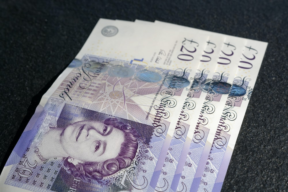four £20 banknotes, money