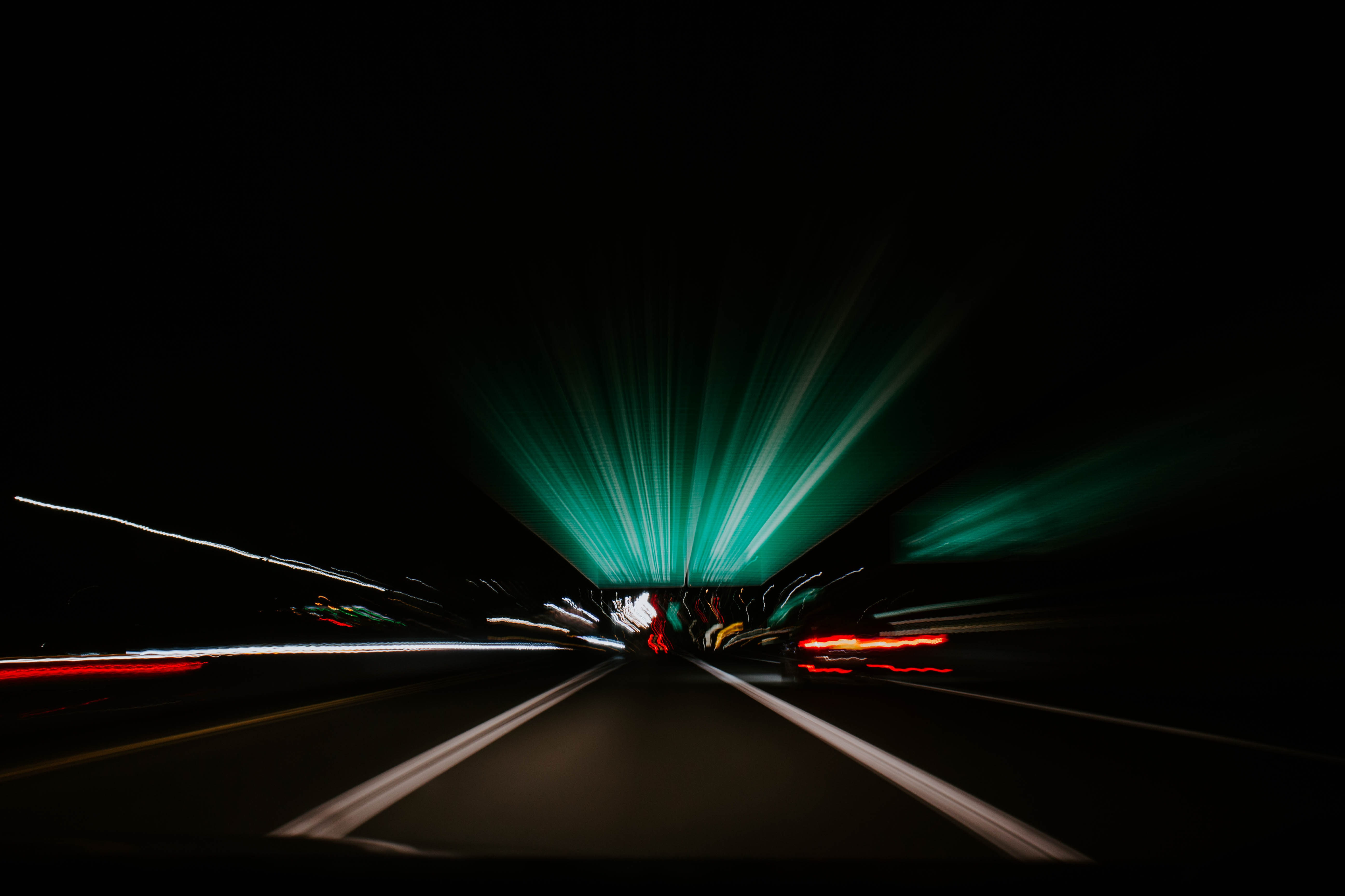 time-lapse photography of vehicle on black top-road at night