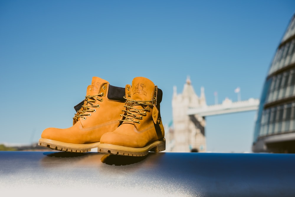 selective focus photography of pair of brown leather work boots