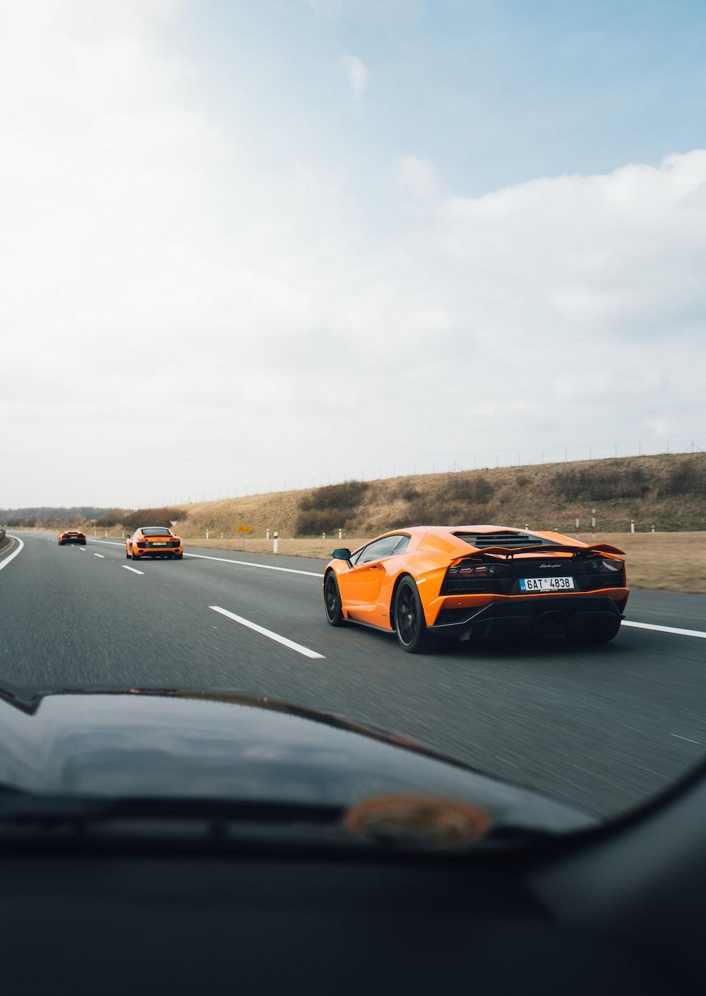 orange Lamborghini on road