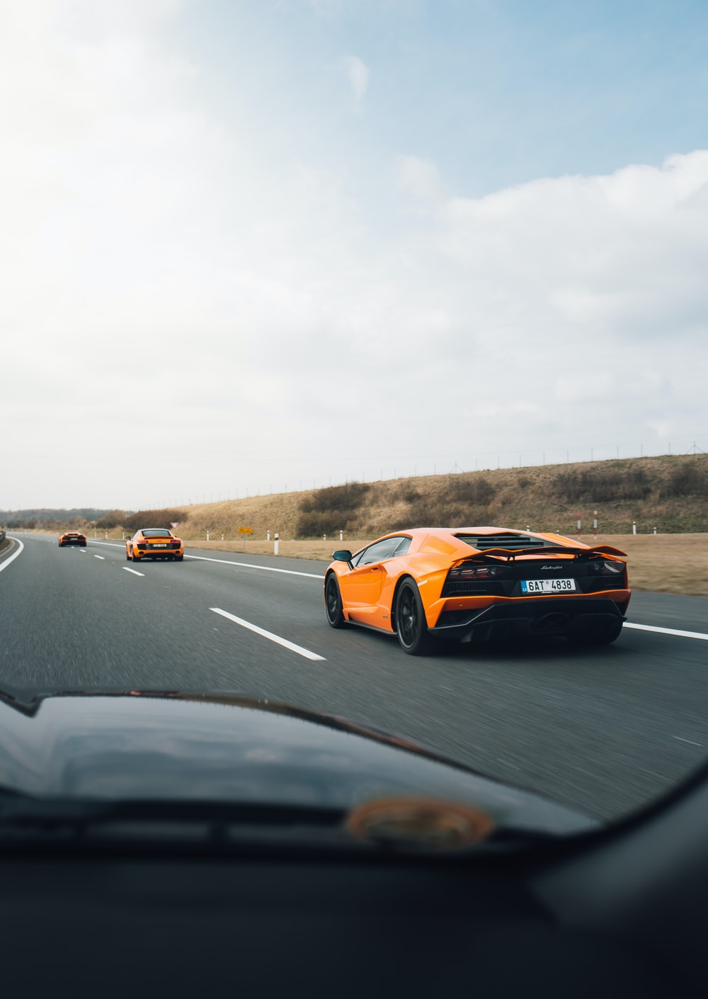 orange Lamborghini on road