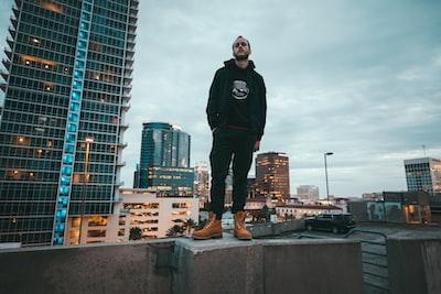 man standing on concrete edge
