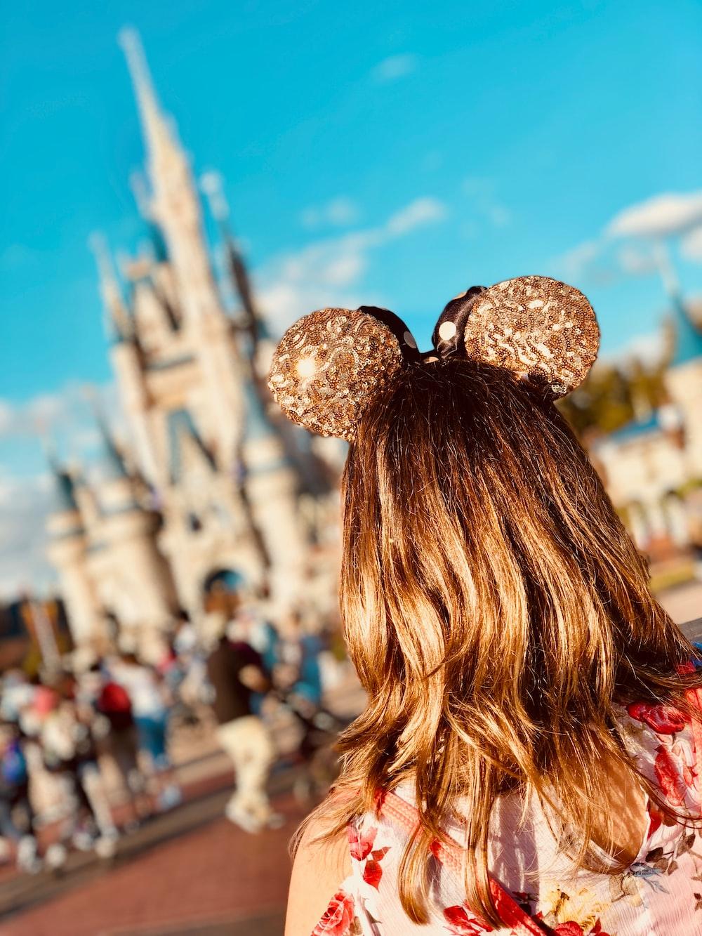 woman wearing golden Mickey Ears at Disneyland