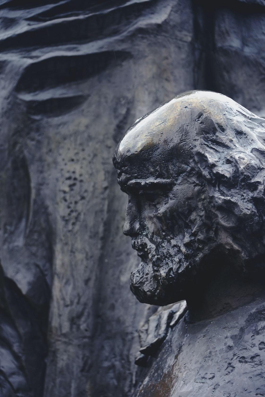 close-up photography of black concrete statue