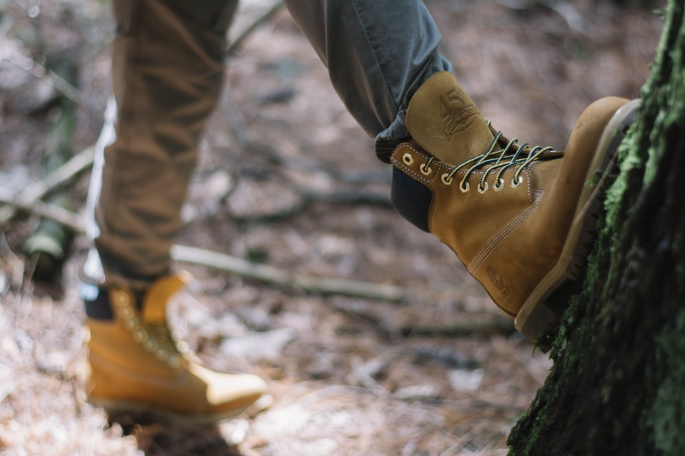 person wearing brown Timberland nubuck work boots