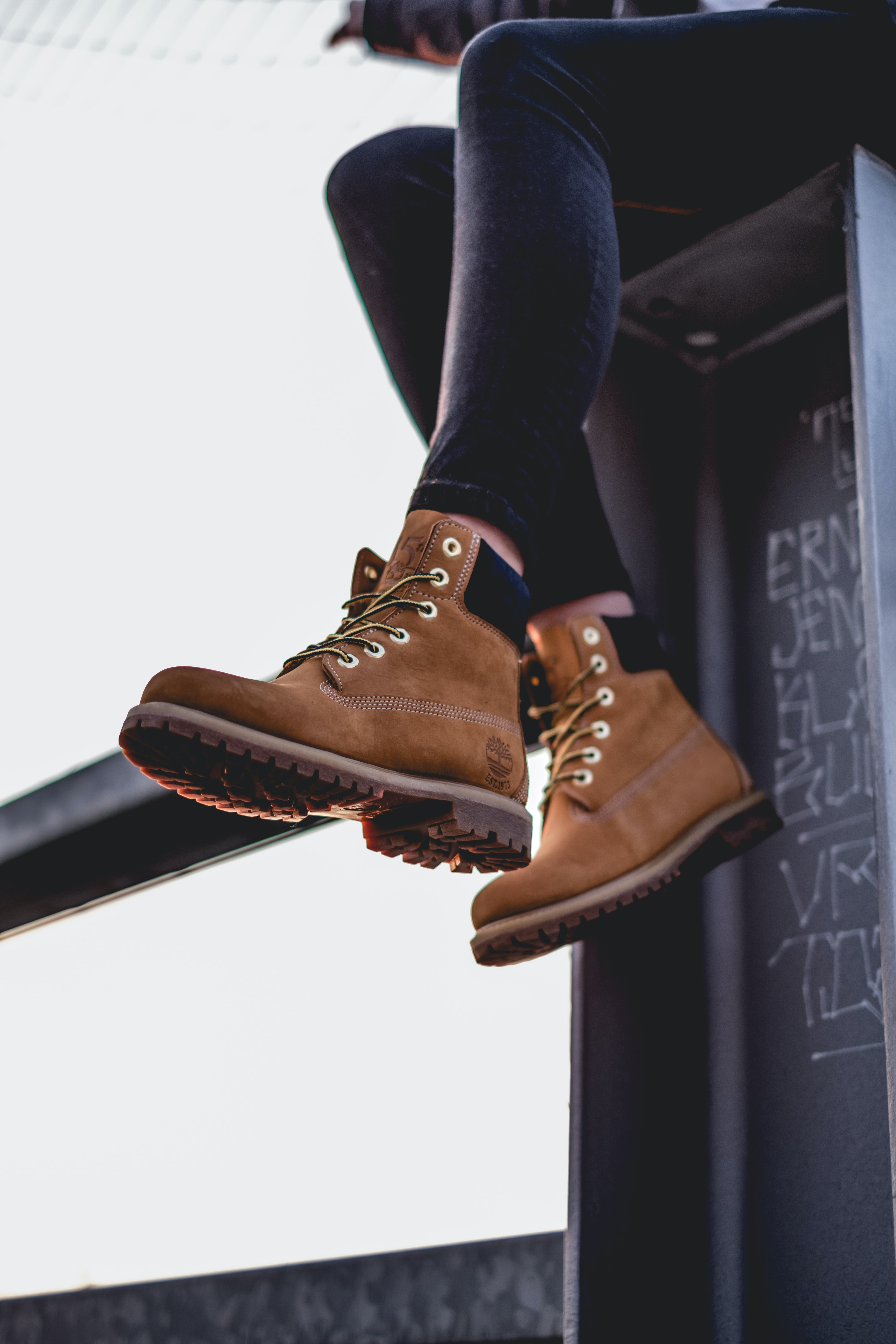 A woman wearing Timberland boots