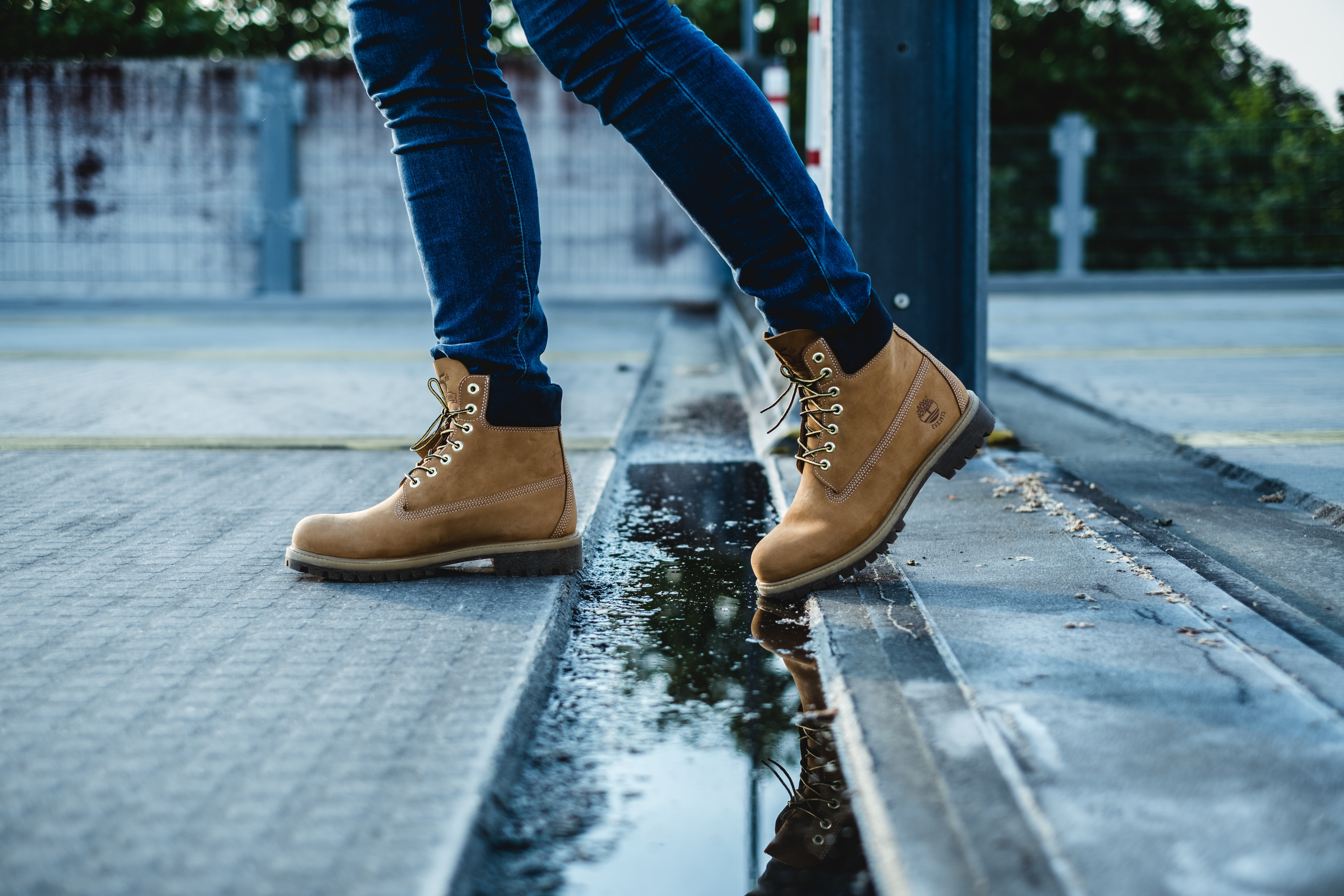 A person walks in the street wearing Timberland boots