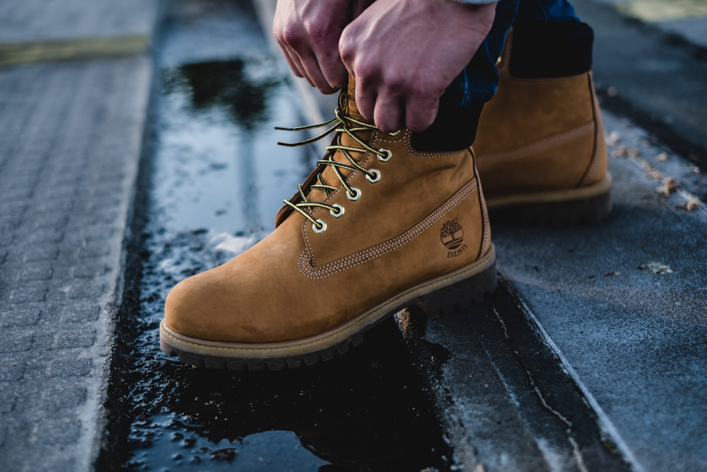man in brown Timberland work boots