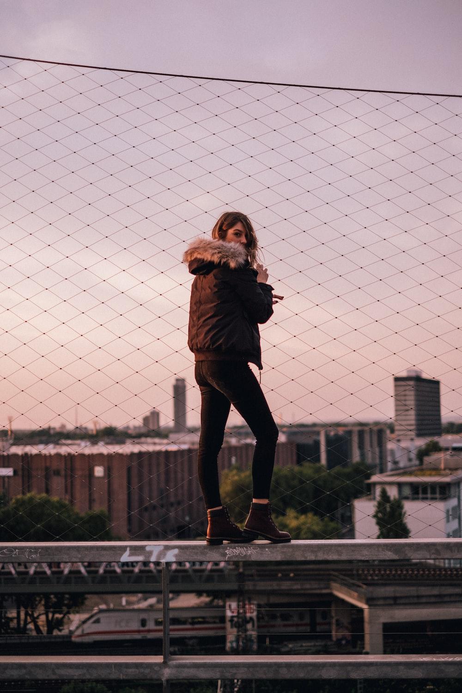 woman standing on railing