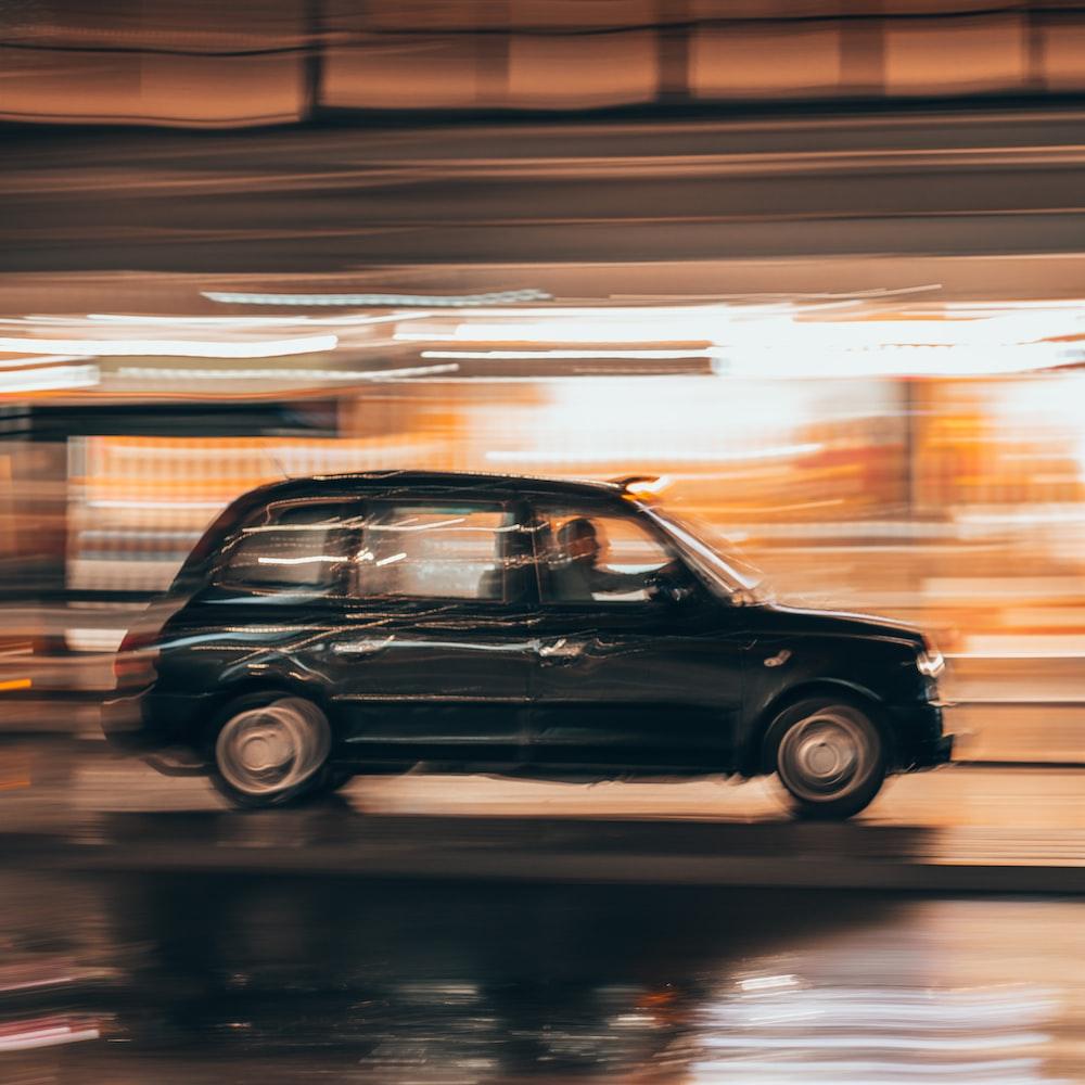 black vehicle running on road