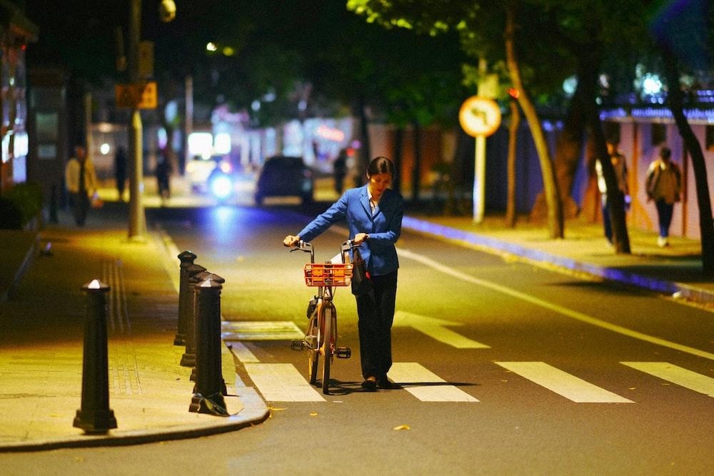 woman pushing her bicycle
