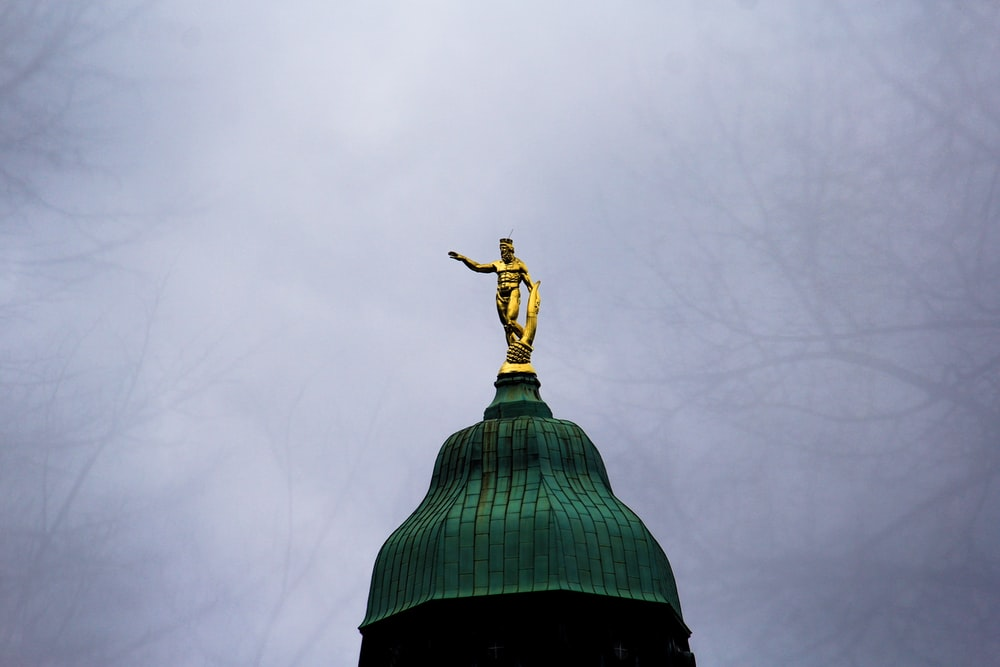 naked man on dome building statue