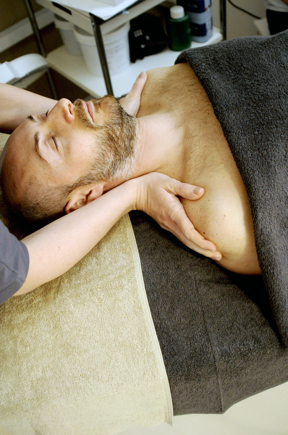 man lying on bed
