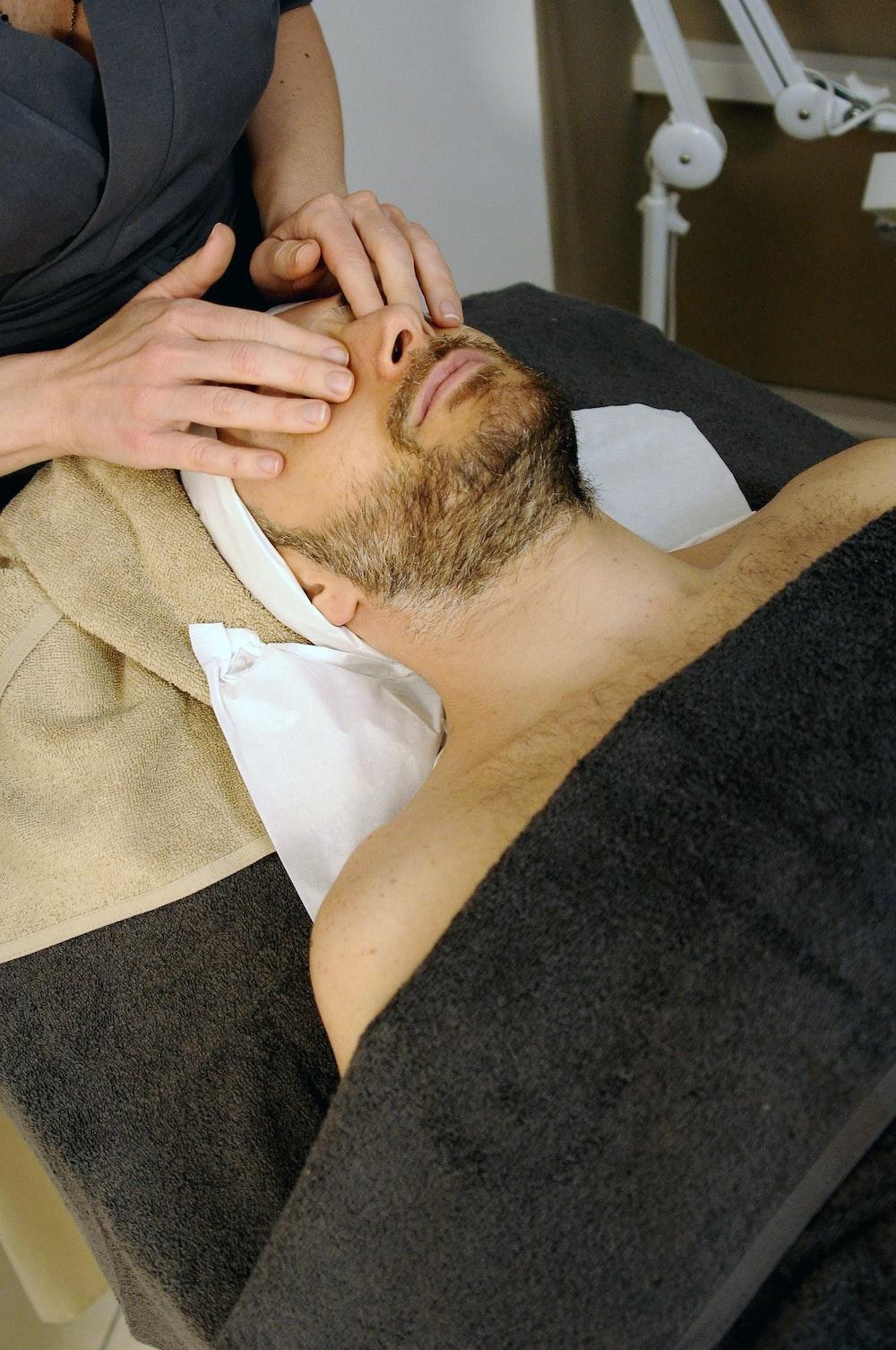 sleeping man while having massage