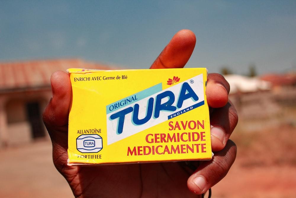 yellow and blue Tura savon germicide mdicamente box