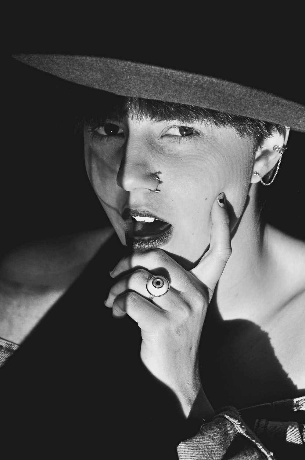 grayscale photography of man wearing cowboy hat