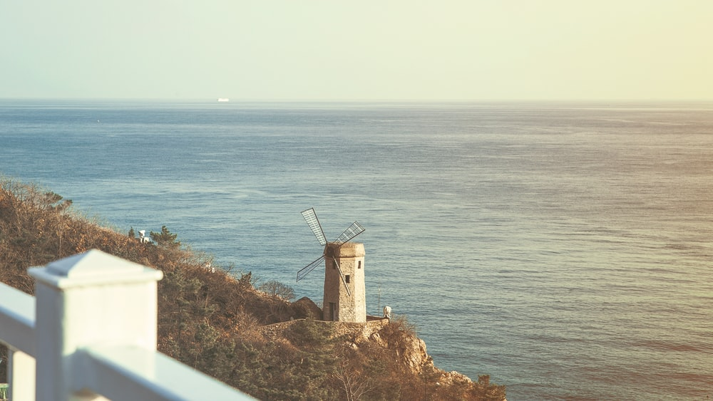 view of lighthouse near body of water
