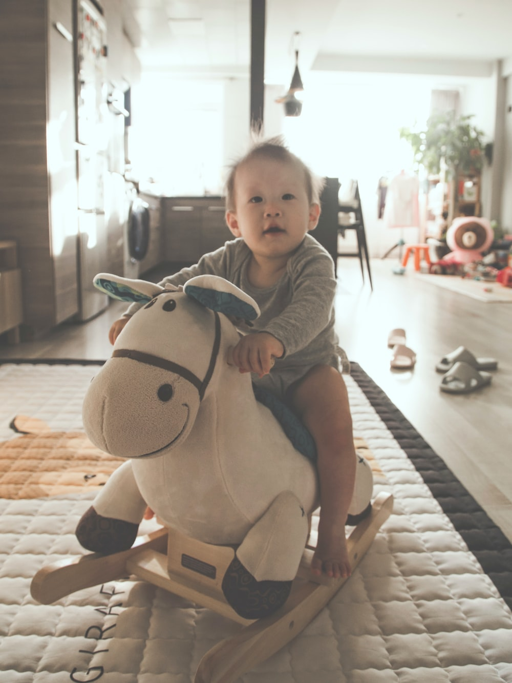 baby riding rocking plush horse