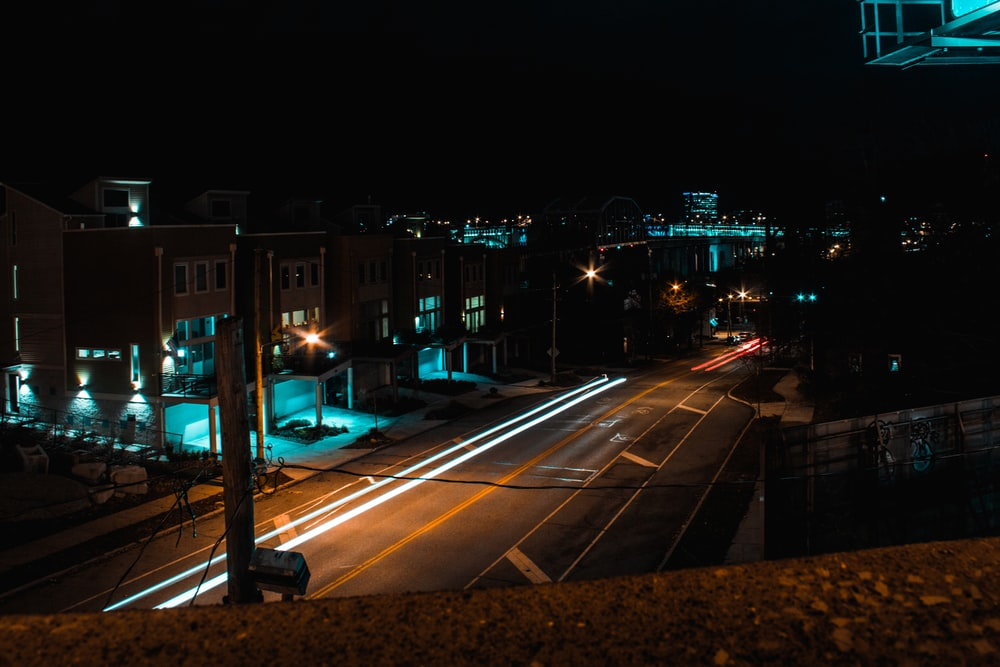 empty gray concrete road at nighttime