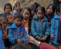 children looking at lollipop