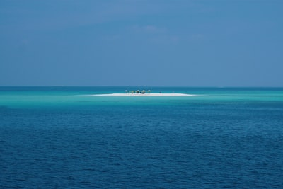 ocean under blue sky during daytime seascape teams background