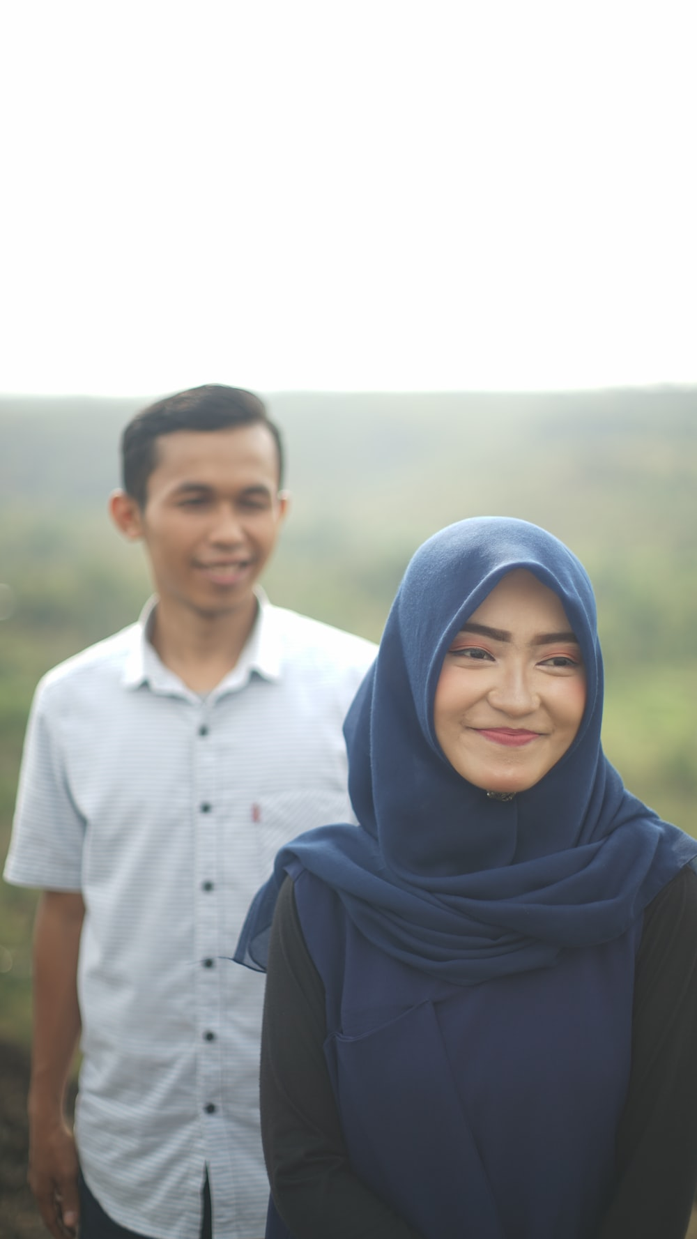smiling woman beside man smiling