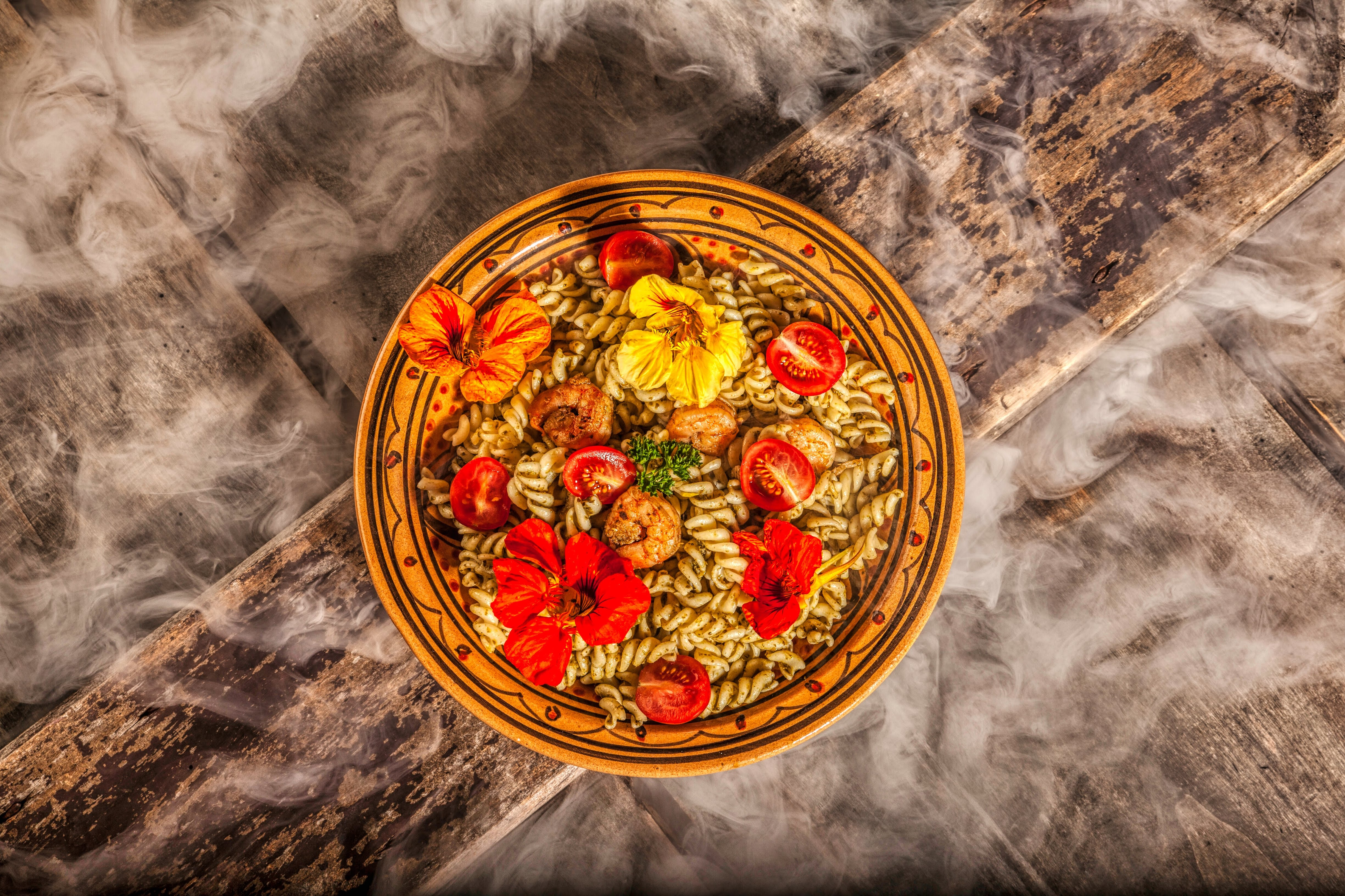 round red and yellow floral ceramic plate