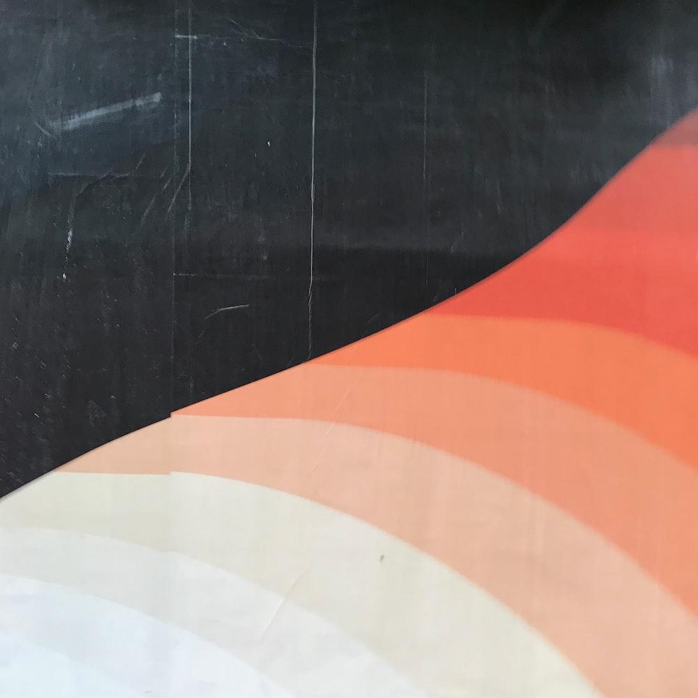 orange and white striped textile