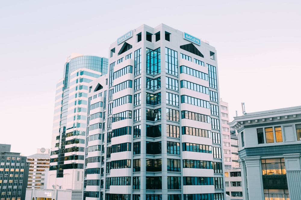 white concrete glass curtain building during daytime