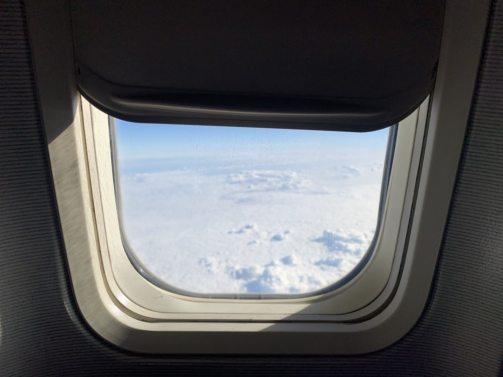 view of clouds through window