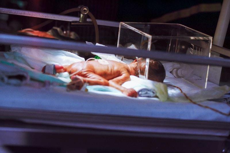 baby on incubator