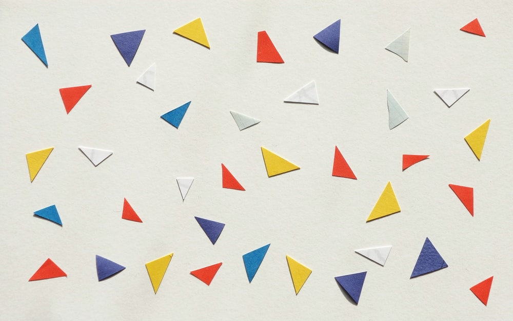 assorted-color paper pieces on white surface