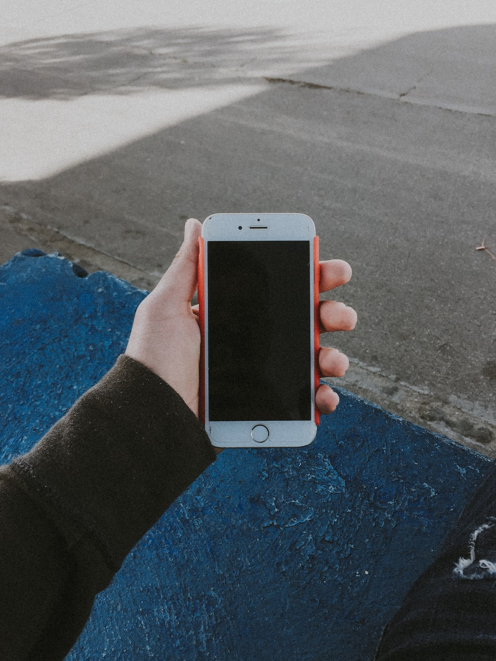 person holding turned-off gold iPhone 6
