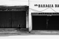 People sitting near by UD Bahagia store, was locate in Kya Kya Chinese town Surabaya