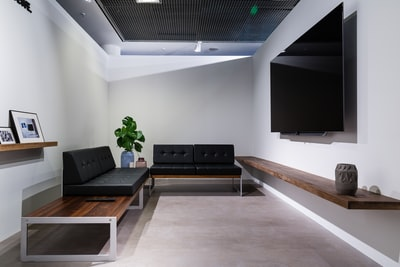 turned-off flat screen tv room teams background