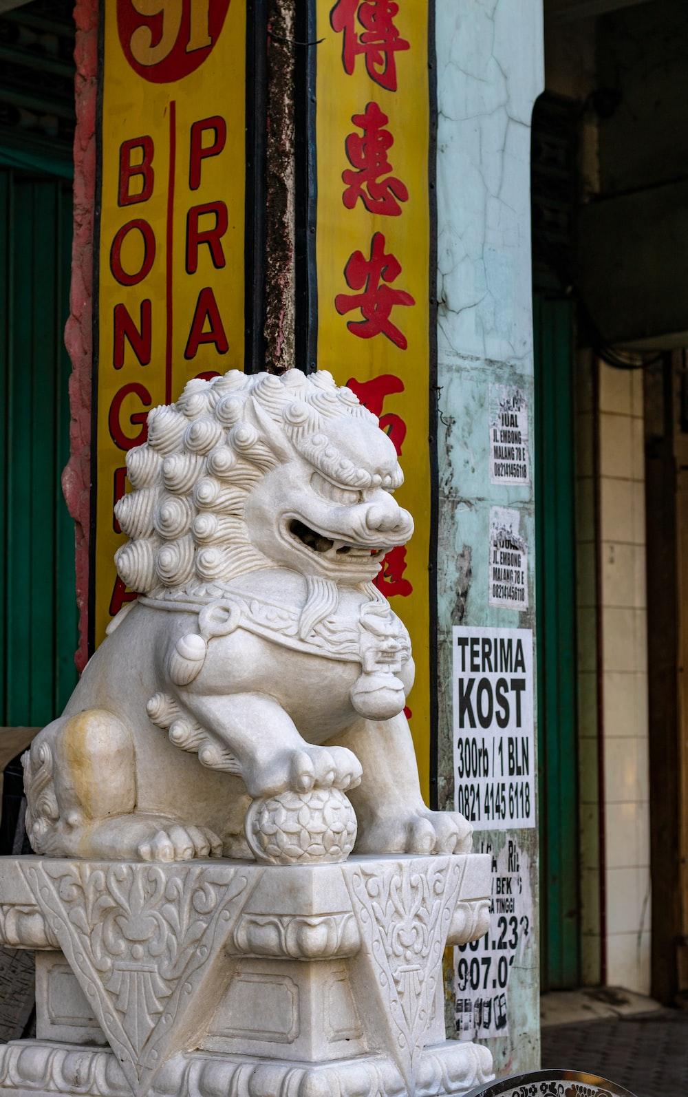 white fu dog statue
