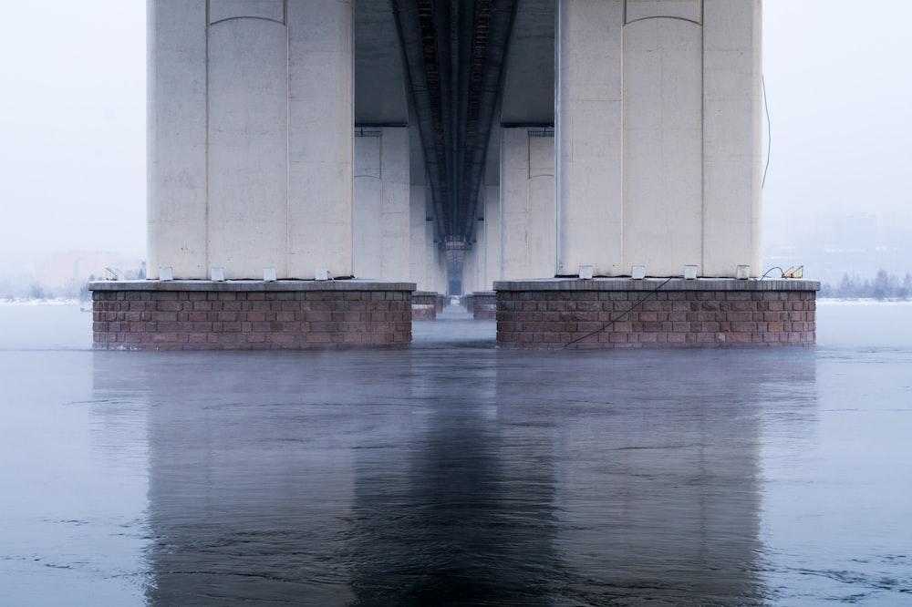 white metal pillars of bridge during daytime