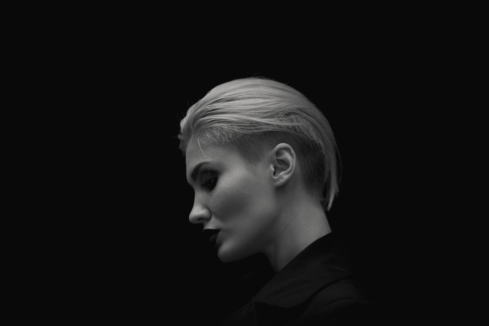 grayscale photography of woman in collared shirt