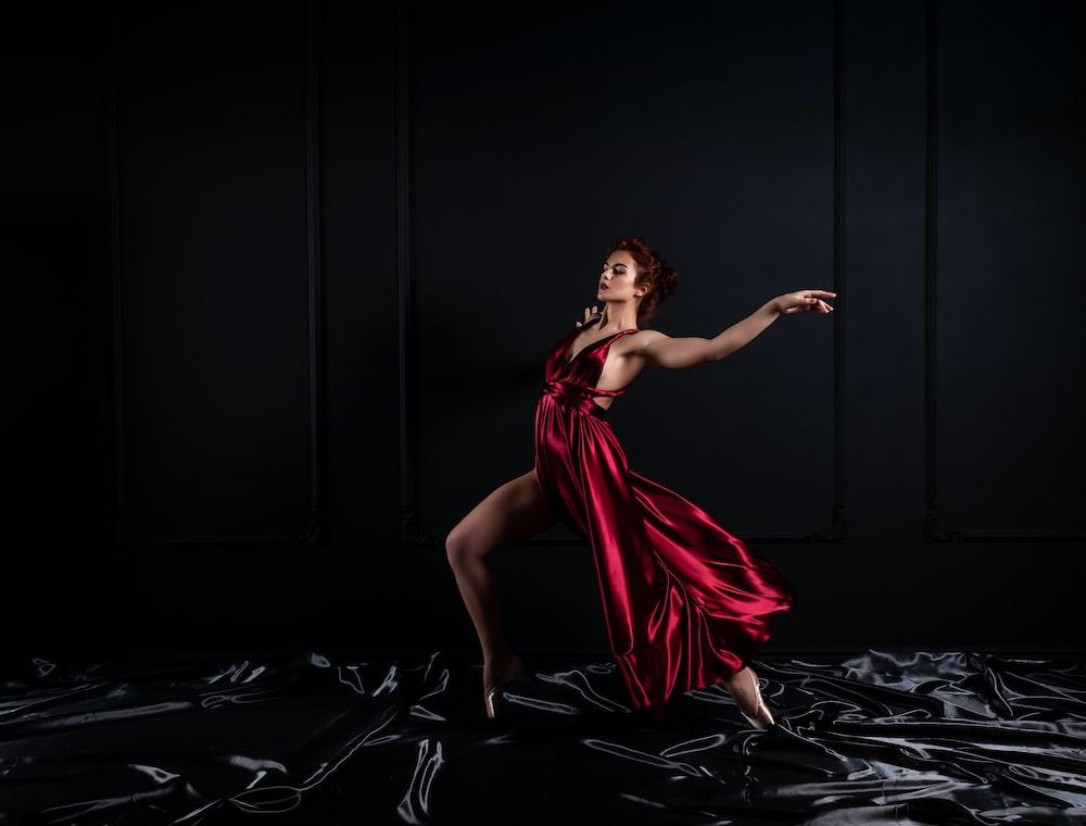 woman wearing red tank satin high slit dress
