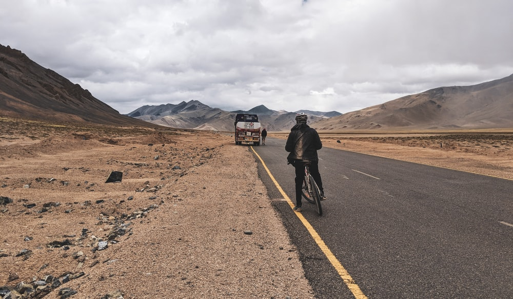 person riding on bicycle on road