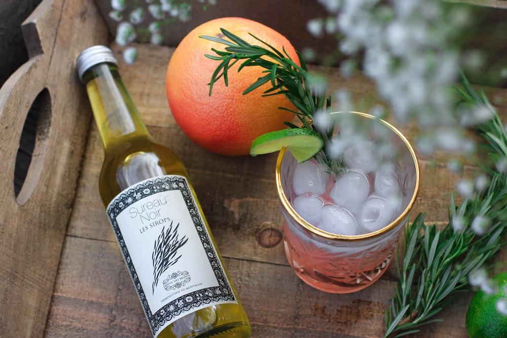 orange fruit and rock glass