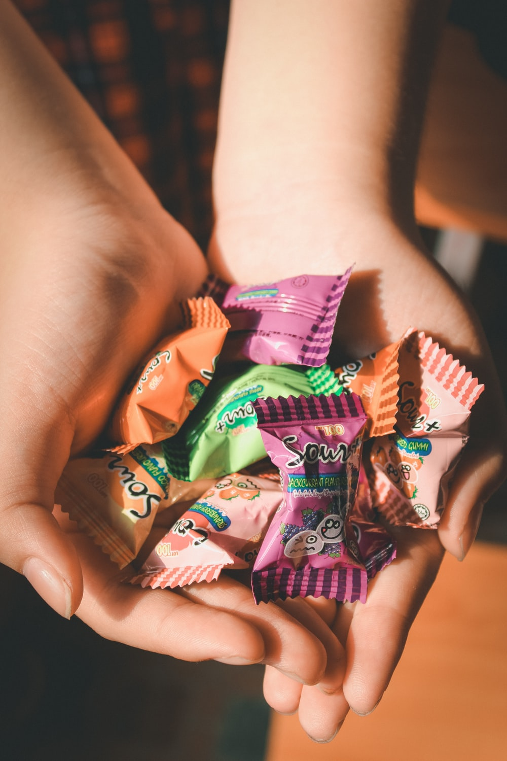 person holding packs of candy