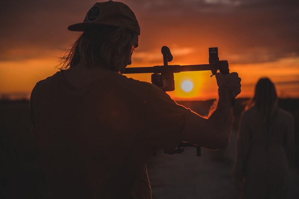 man holding camera stick