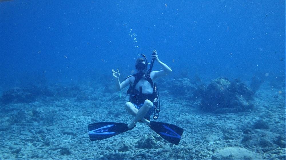 underwater photo of woman