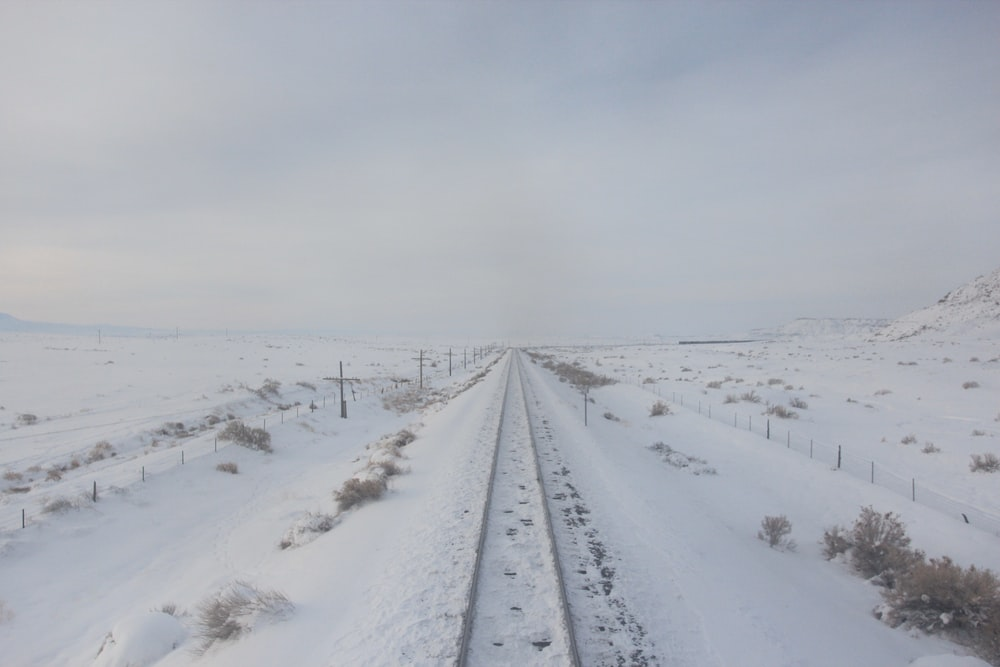 road covered with snow during daytime